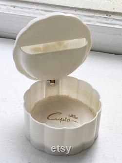 Vintage Celluloid Powder Box with 'Cuopidon' Puff.