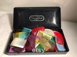 Vintage Oscar De La Renta box with several hair combs.